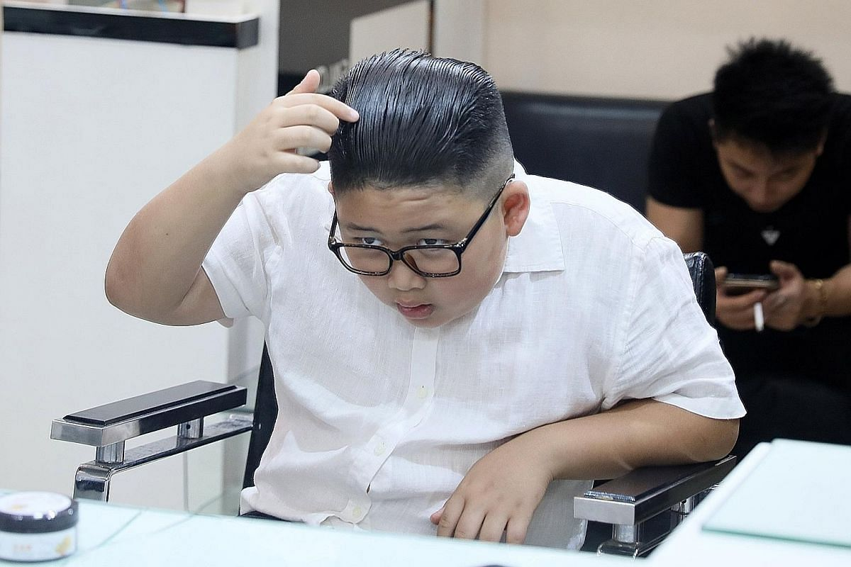 Nine-year-old To Gia Huy checking out his Kim Jong Un-style haircut while 66-year-old Le Phuc Hai admires his Donald Trump-inspired dyed hairdo at a salon in the Vietnamese capital, Hanoi, ahead of the US-North Korea summit this week.