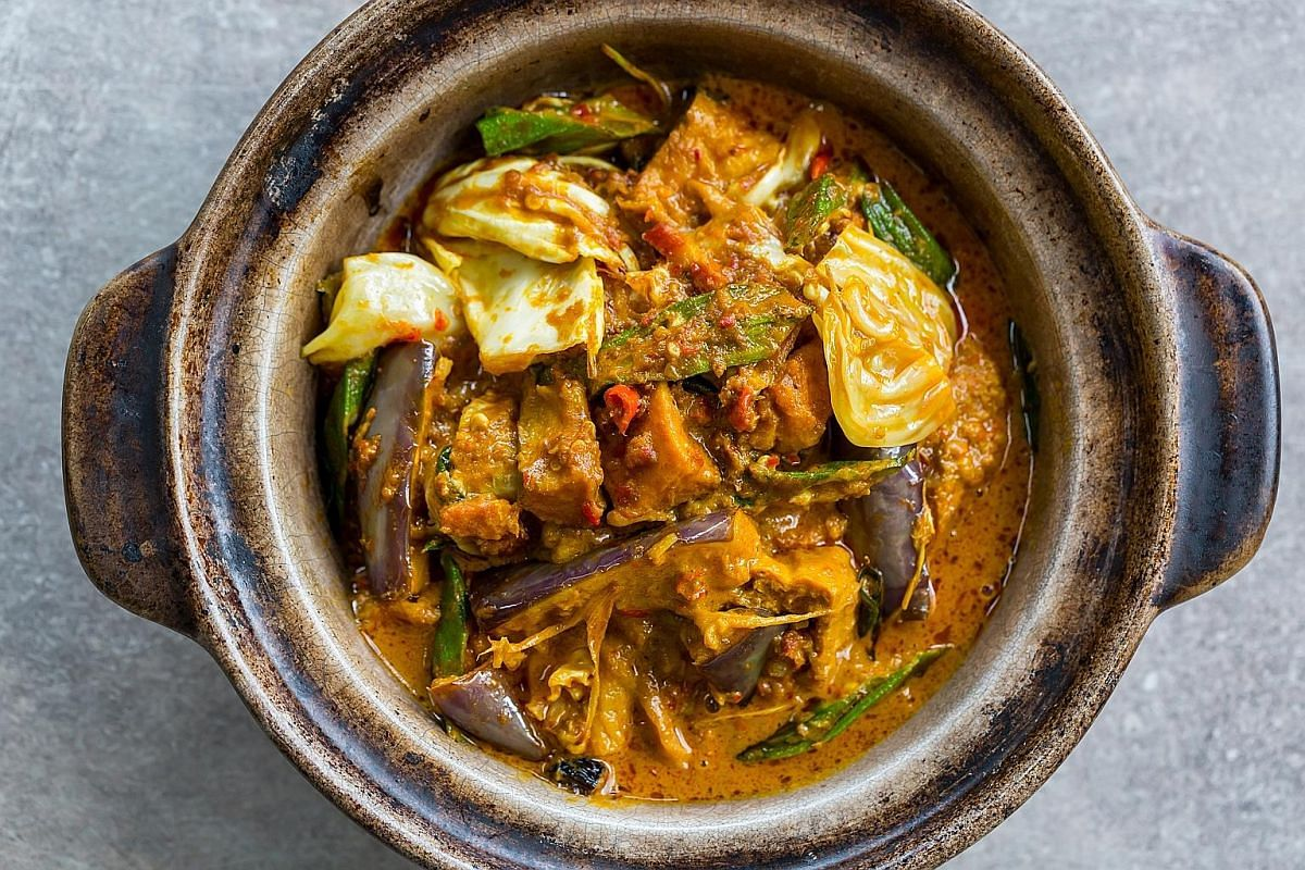 Smoked Pork Curry is an odd dish of house-smoked pork belly cooked in a thick curry with eggplant, lady's finger, cabbage and tau pok.