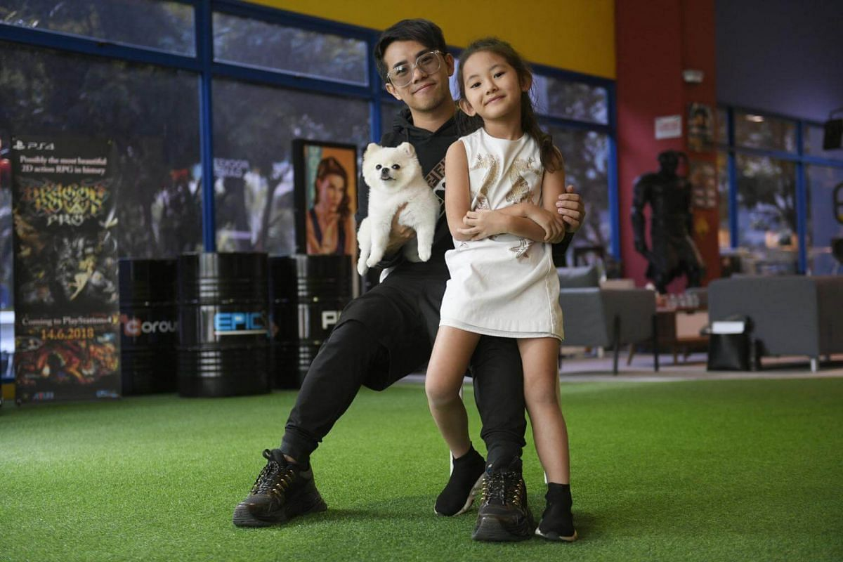 Local YouTube personality Jianhao Tan with his Playtime TV co-host Cindy and dog BunCha, an Instagram star with more than 87,000 followers.