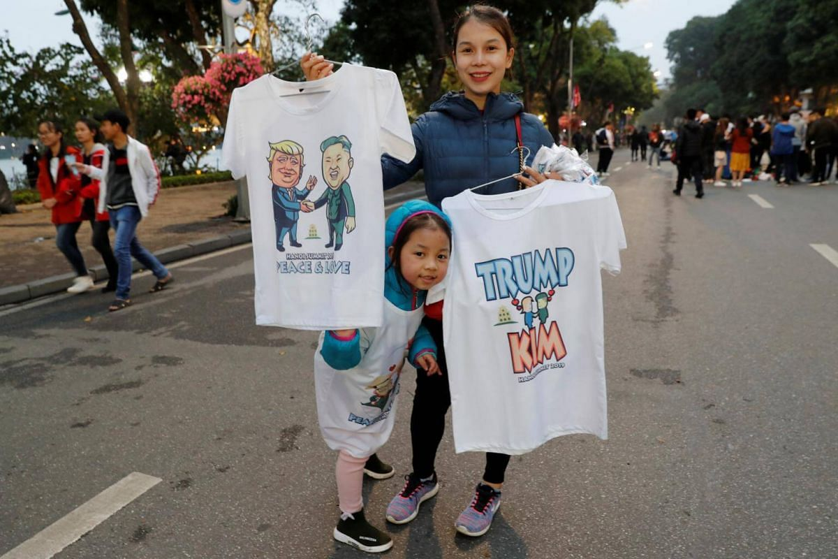 A woman sells T-shirts depicting Mr Kim and Mr Trump on Feb 23, 2019.