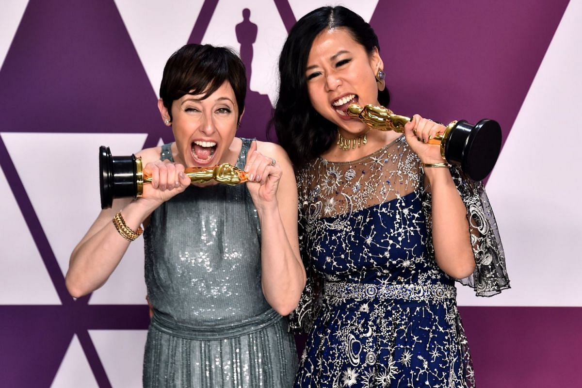 Bao producer Becky Neiman-Cobb (left) and director Domee Shi with their awards for Best Animated Short.