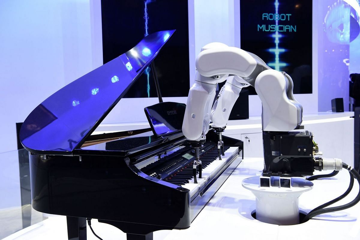 A ZTE musician robot plays the piano at the Mobile World Congress (MWC) in Barcelona on February 25, 2019. PHOTO: AFP