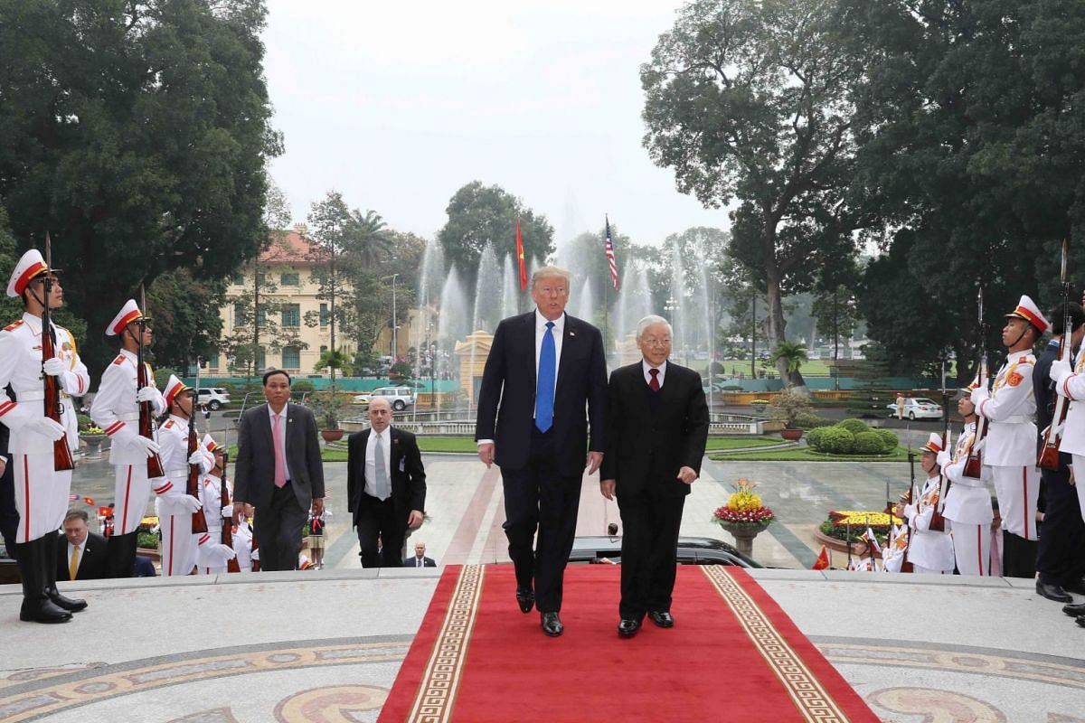 US President Donald Trump and Vietnamese President Nguyen Phu Trong review the guard of honor during their meeting ahead of the US-North Korea summit in Hanoi, Vietnam, on Feb 27, 2019.