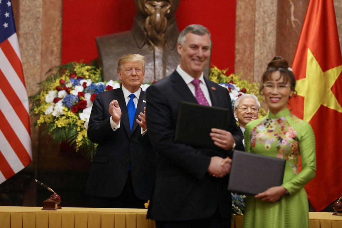 US President Donald Trump and Vietnamese President Nguyen Phu Trong applaud after a signing ceremony at the Presidential Palace in Hanoi, Vietnam, on Feb 27, 2019.