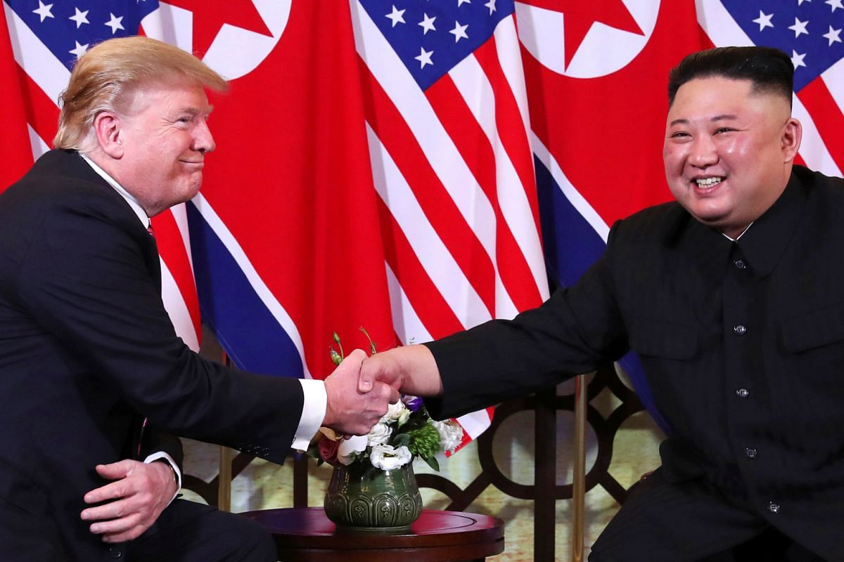 US President Donald Trump and North Korean leader Kim Jong Un spoke to reporters briefly before their meeting at Sofitel Legend Metropole Hotel in Hanoi on Feb 27, 2019.