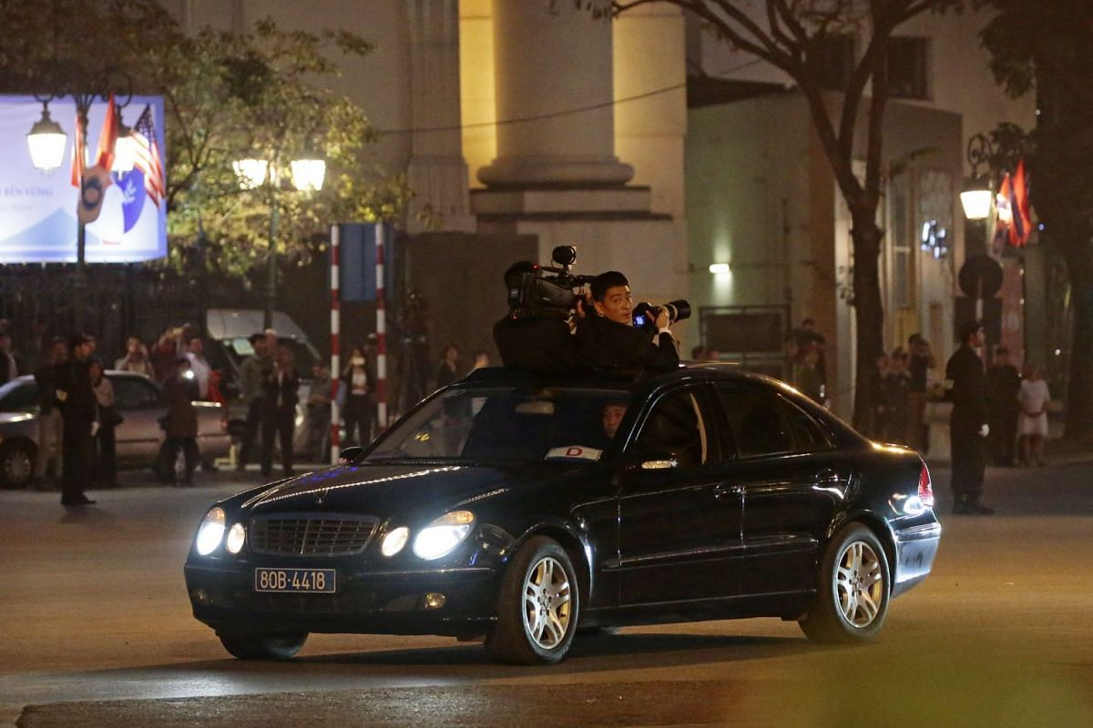North Korean cameramen are seen in the motorcade carrying North Korean leader Kim Jong Un as he arrives at Sofitel Legend Metropole Hotel for his meeting with US President Donald Trump on Feb 27, 2019.