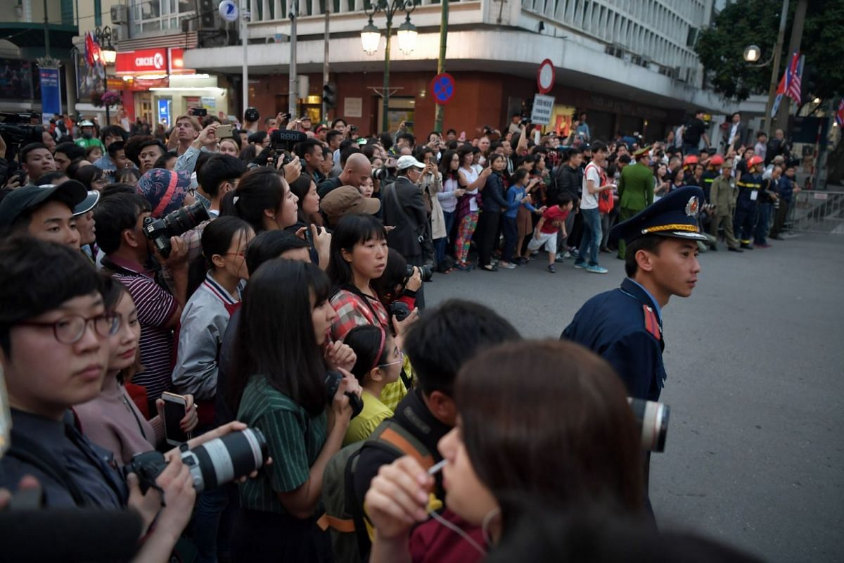 Crowds gather outside Sofitel Legend Metropole Hotel to catch a glimpse of US President Donald Trump and North Korean leader Kim Jong Un in Hanoi on Feb 27, 2019.