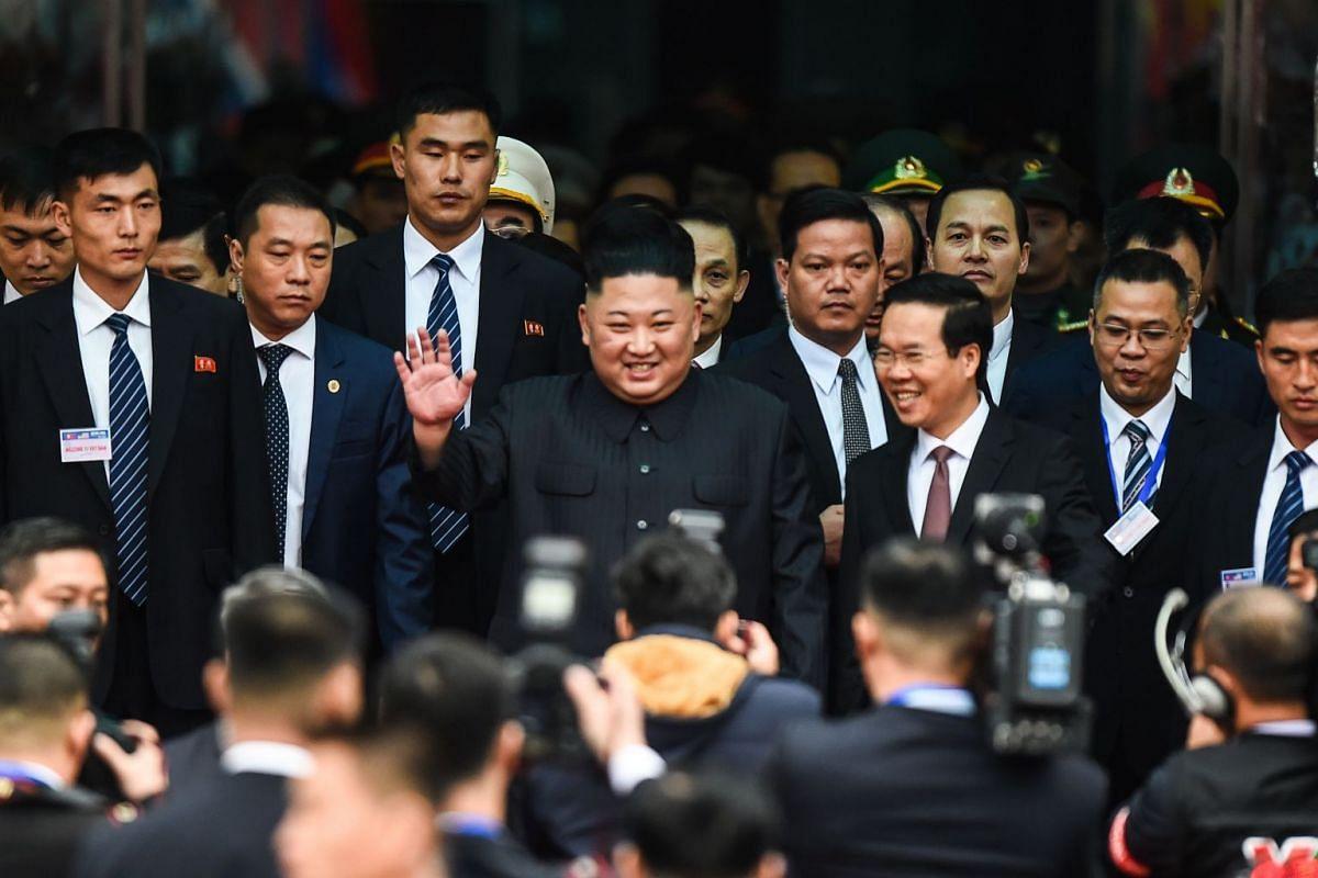 North Korean leader Kim Jong Un waves after arriving at Dong Dang railway station in Dong Dang, Lang Son province, Vietnam, on Feb 26, 2019.