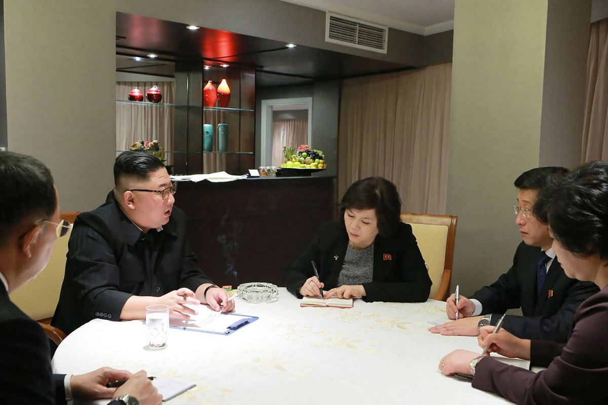 North Korean leader Kim Jong Un receives a situation report before the summit meeting with US President Donald Trump at a hotel in Hanoi, Vietnam, on Feb 26, 2019.