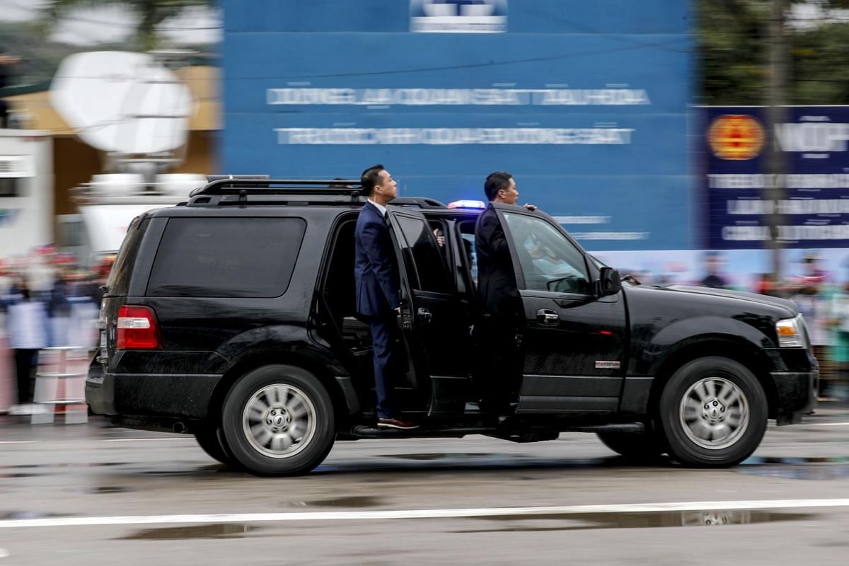 Bodyguards follow North Korean leader Kim Jong Un in the motorcade as he makes his way from Dong Dang to Hanoi, ahead of the second US-North Korea summit in Vietnam, on Feb 26, 2019.