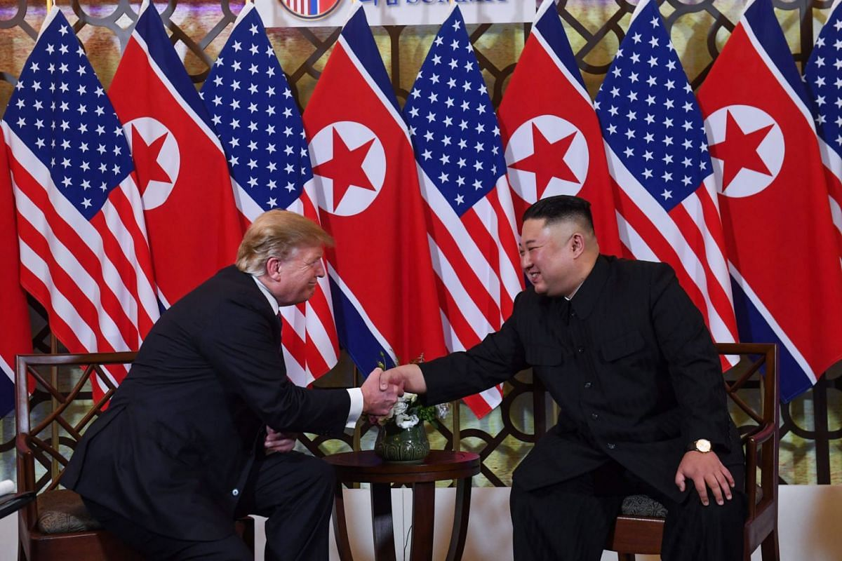 US President Donald Trump (L) shakes hands with North Korea's leader Kim Jong Un following a meeting at the Sofitel Legend Metropole hotel in Hanoi on February 27, 2019. PHOTO: AFP