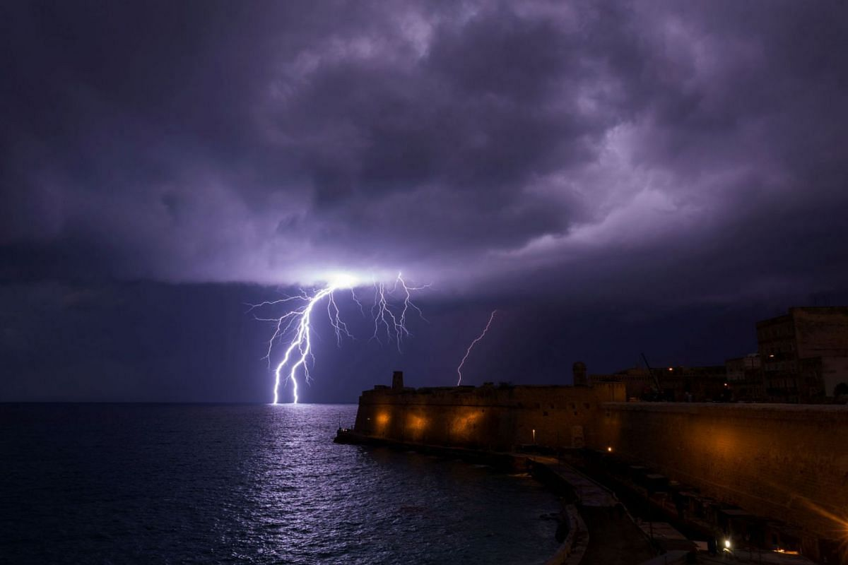 A lightning bolt strikes the sea near Fort St Elmo during a storm in Valletta, Malta on February 27, 2019. PHOTO: REUTERS
