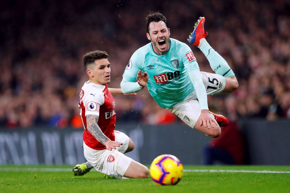 Arsenal's Lucas Torreira in action with Bournemouth's Adam Smith during the Premier League football match between Arsenal and AFC Bournemouth  at the Emirates Stadium, London, Britain on February 27, 2019. PHOTO: REUTERS