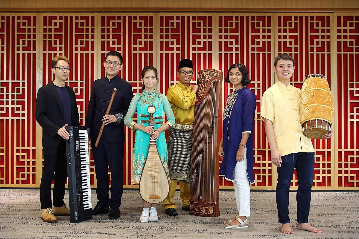 Pupils Krishiv Pappu (left) and Rohan Nanduri have won prizes for playing the sheng, a traditional Chinese wind instrument. (From left) Keyboard player Lu Heng is the music director of yIN Harmony, an ethnic music group that crosses cultures and was