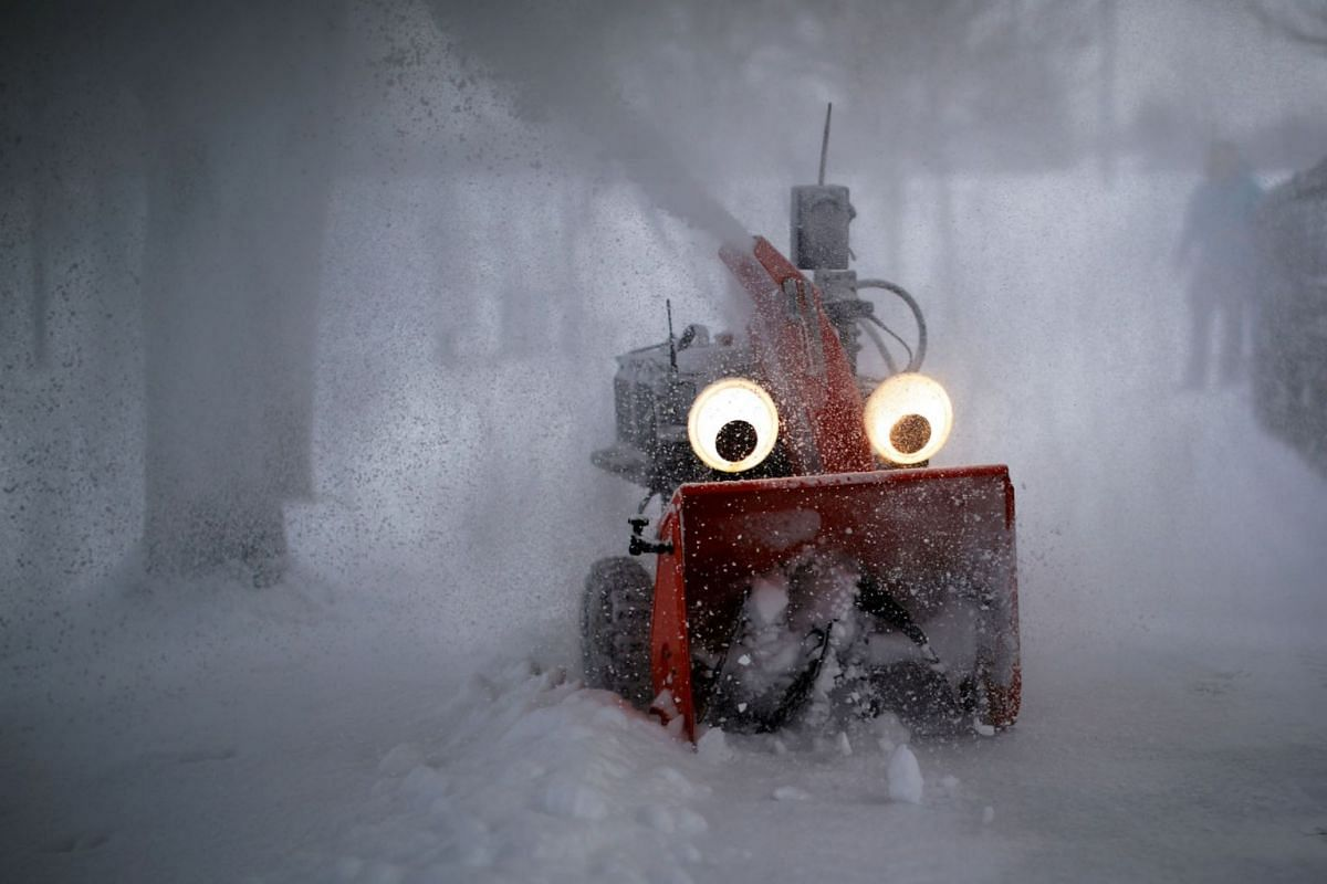 """""""Chomper,"""" a semi-autonomous, GPS-guided snow blower designed and built by MIT research engineer Dane Kouttron, clears snow following an overnight storm in Cambridge, Massachusetts, U.S., February 28, 2019. PHOTO: REUTERS"""