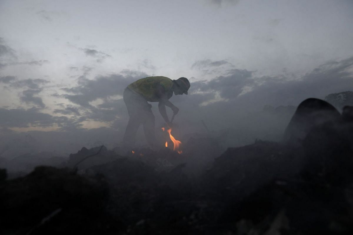 Venezuelan man Eli Silvio, 22, looks for recyclables at a garbage deposit in Pacaraima, Brazil February 28, 2019. PHOTO: REUTERS