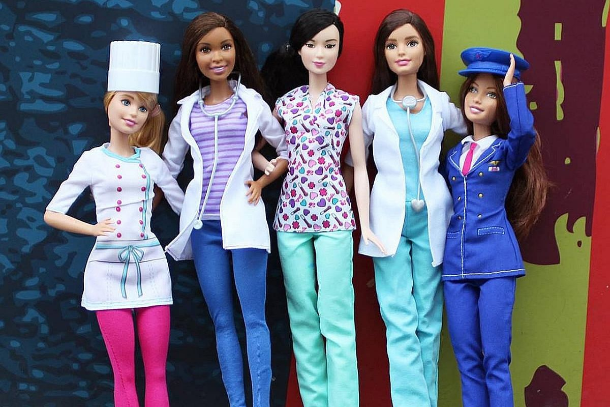 (Left) Barbie and friends in various occupations including surgeon and chef. (Right) A 2009 Tangs limited-edition Barbie. In collaboration with Mattel, fashion brands sold in the department store - including Daniel Yam and Island Shop - designed 30 d