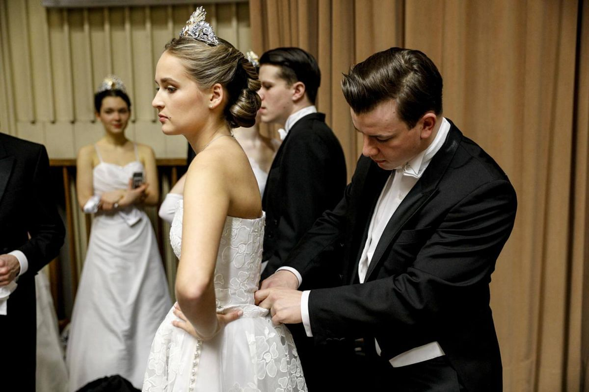 Debutantes and debutants prepare backstage prior to the opening ceremony of the traditional 63rd Vienna Opera Ball at the State Opera.
