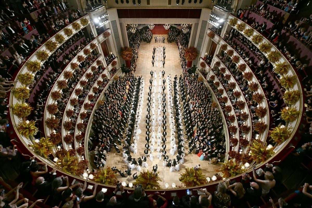 Members of the opening committee line up to perform during the opening ceremony of the Vienna Opera Ball 2019 at the Vienna State Opera.