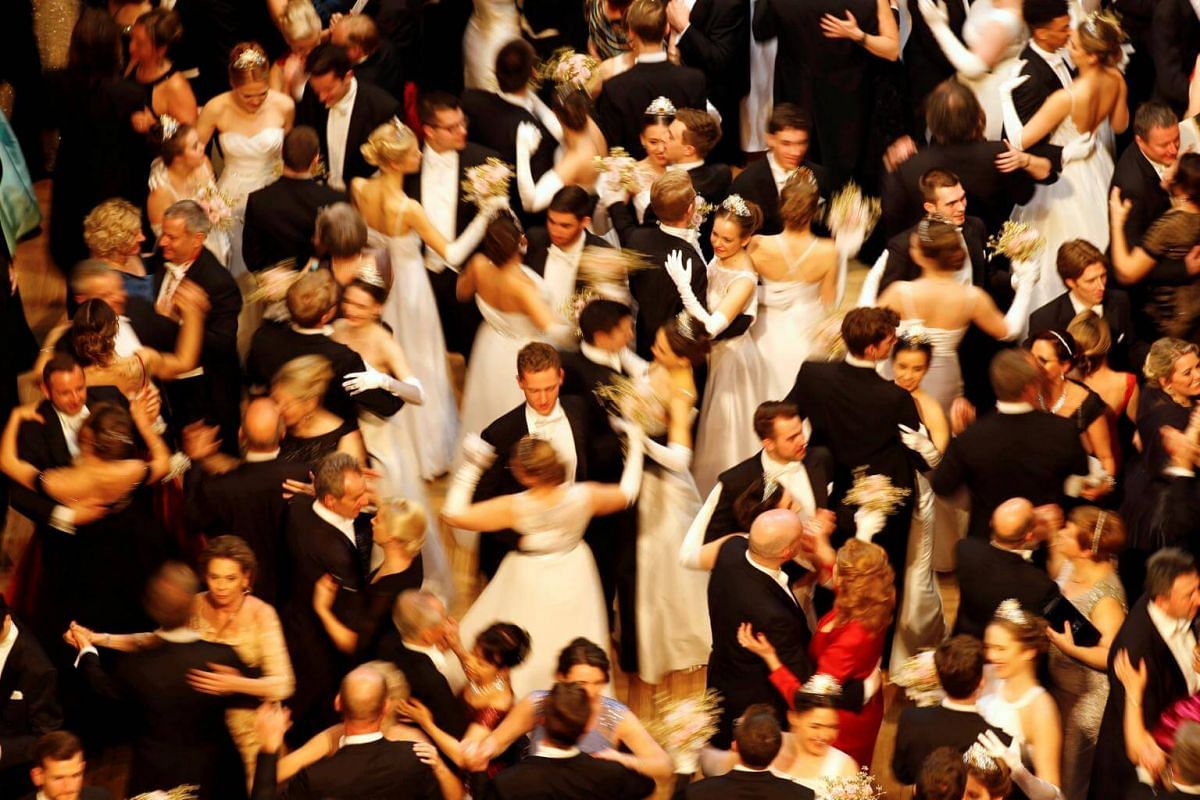 Guests dance alongside members of the opening committee after the opening ceremony of the traditional Opera Ball in Vienna, Austria, on Feb 28, 2019.