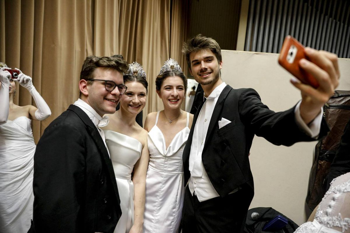 Some of the young people backstage prior to the opening ceremony of the traditional 63rd Vienna Opera Ball at the State Opera.
