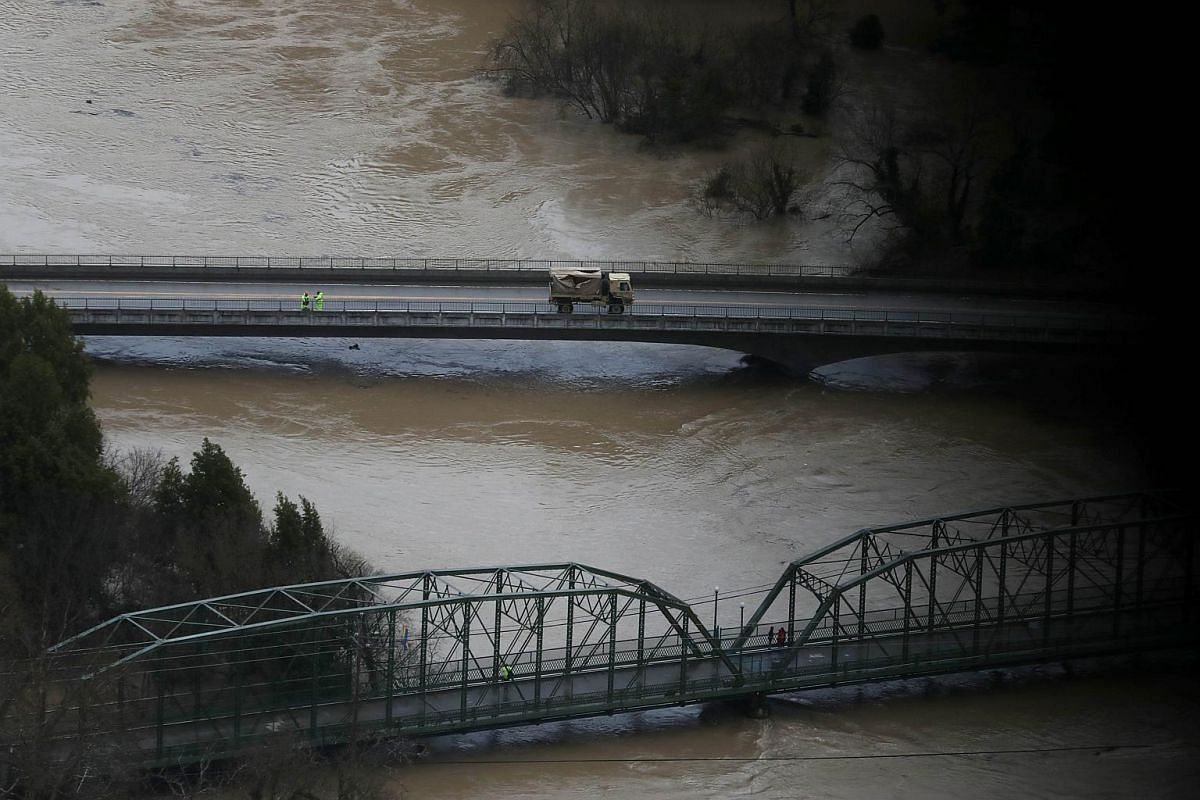 A military vehicle sits on a bridge over the Russian River on Feb 27, 2019, in Guerneville, California.