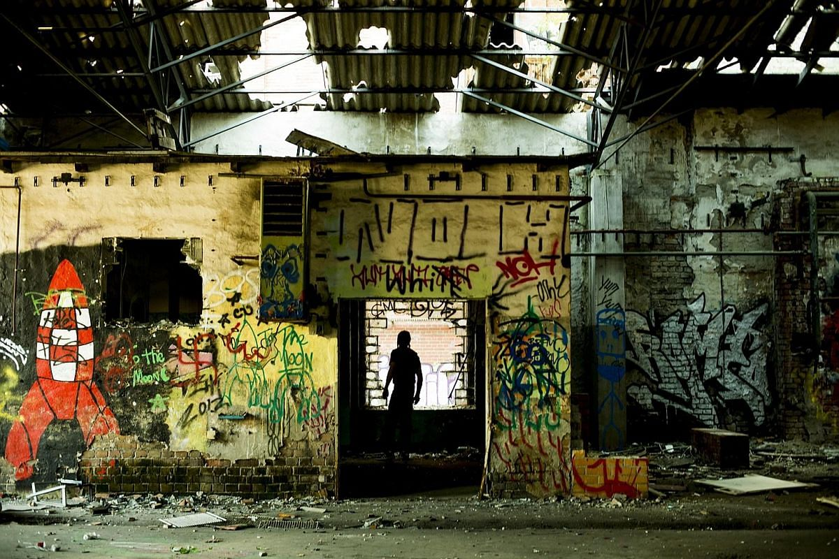 The writer's host Giacomo (in silhouette) took her to look for an abandoned warehouse in Berlin to photograph in 2013.