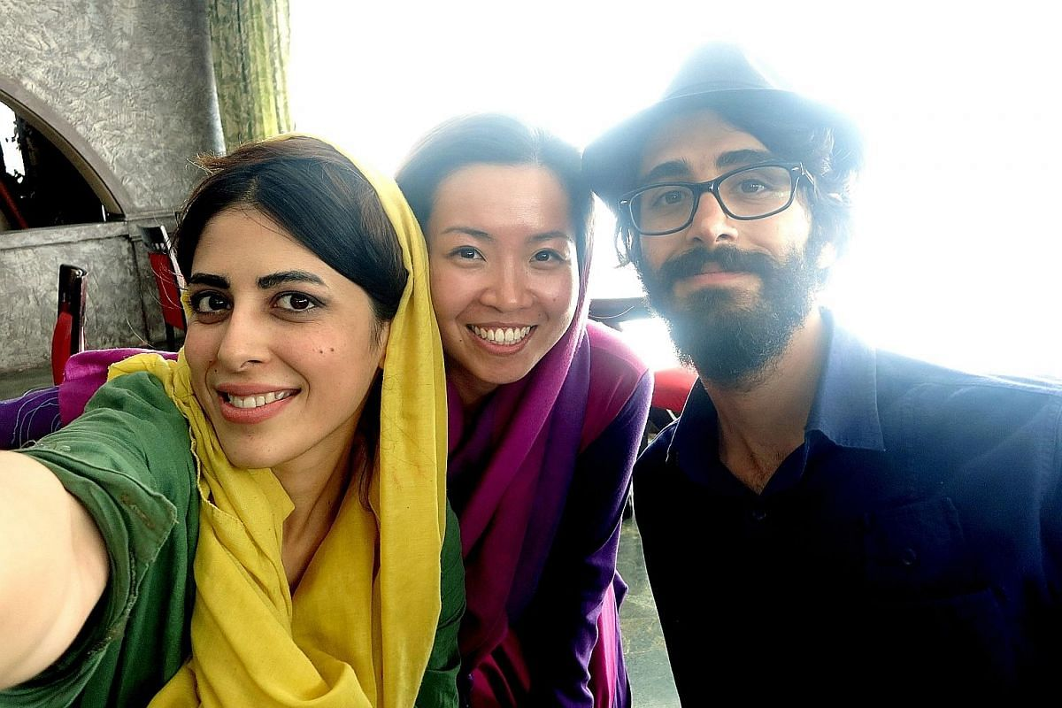 The writer (centre) met Shirin, a Couchsurfer (left) in Shiraz, who introduced her to her boss (right), Hussein, a young entrepreneur. The three of them ended up hanging out together, talking about pop culture and favourite ice cream flavours.