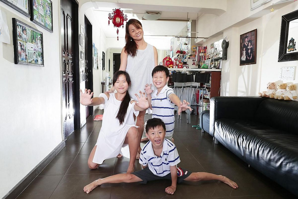 Ms Elizabeth Li with her children Chelsea, 13, Christian, 11, and Chasten, five. She practised breastfeeding on demand and making purees from scratch for them when they were younger and does not regret the labour-intensive practices.