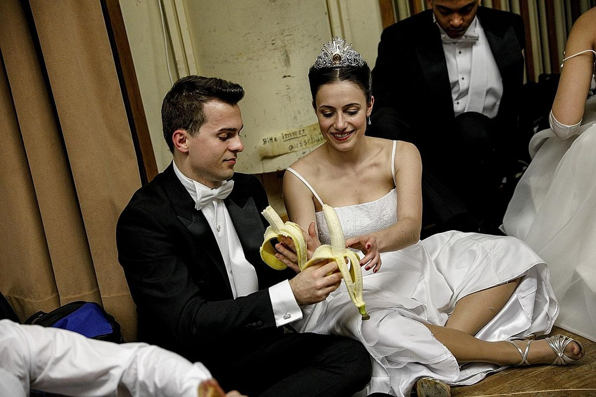 BEHIND THE SCENES: Debutantes fuelling up with bananaS before the opening ceremony of the Vienna Opera Ball last Thursday.