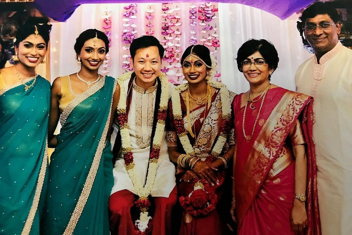 Mrs Sarojini Padmanathan and her husband T. Padmanathan with their daughters (from far left) Uma, Bhaama and Hema and son-in-law Daryl Cheng in 2016. She says the focus on academics is not new.