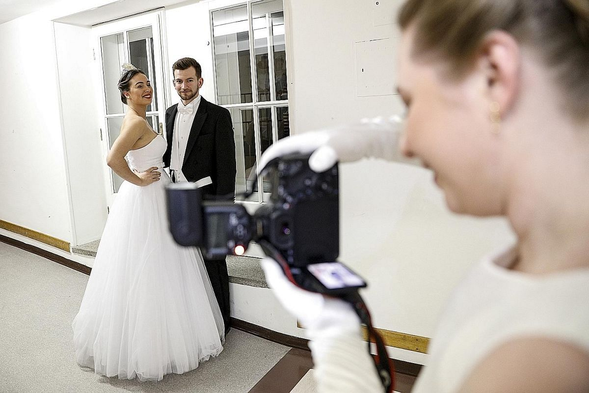 BEHIND THE SCENES: Debutantes having their photos taken backstage before the opening ceremony of the Vienna Opera Ball last Thursday.