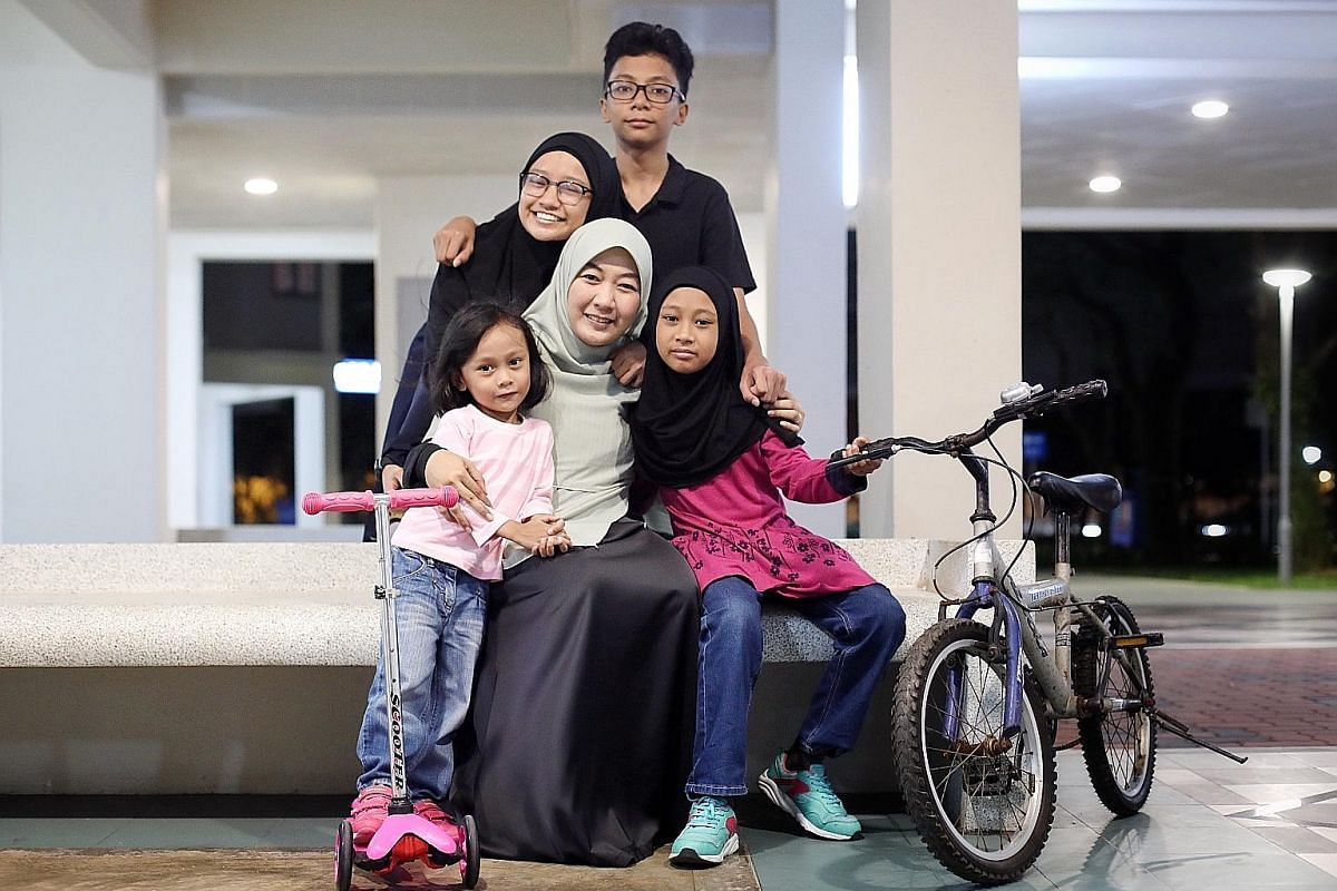 Ms Suhaila Subtu with her children (clockwise from left) Ayla Zulaykha, four; Sara Syaakirah, 14; Umar Abdul Aziz, 12; and Huda Nusaybah, nine. Ms Suhaila, who has taken parenting classes, says there is a lot to keep up with for each child and his or her