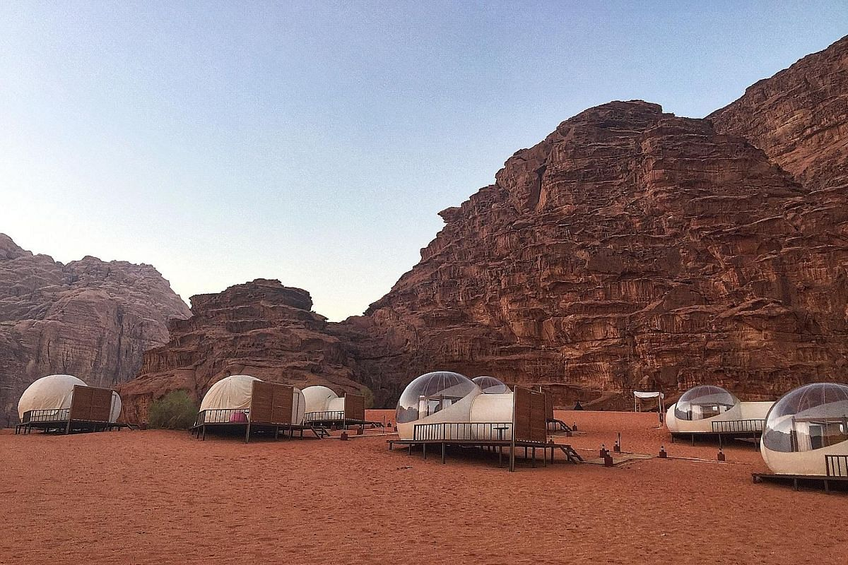 Spending the night in a bubble tent lets guests sleep under the stars while still enjoying creature comforts, like a bathroom and air-conditioning.