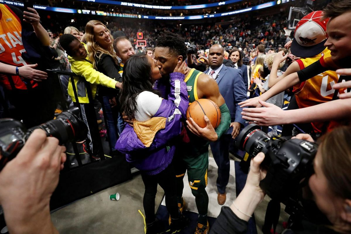 Utah Jazz guard Donovan Mitchell (45) receives a kiss from his girlfriend Deja Lighty after his career high 46-point game against the Milwaukee Bucks at Vivint Smart Home Arena in Salt Lake City, Utah, USA on March 2, 2019. PHOTO: USA TODAY SPORTS