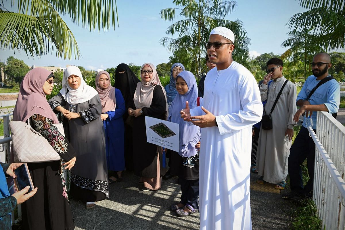 Participants of the Jenazah Management Course with Mr Razaly at the Pusara Aman Cemetery, where they will observe a burial. The deceased's family has given permission for Mr Razaly to attend the burial for educational purposes.
