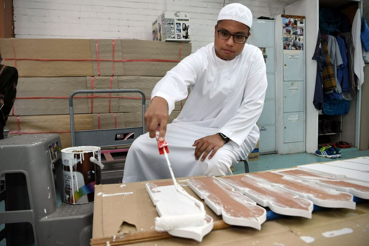 Mr Razaly paints temporary tomb markers known as kayu nisan, on which details of the deceased are written before the actual tombstone is erected. Grave markers are simple as lavish displays are discouraged in Islam.