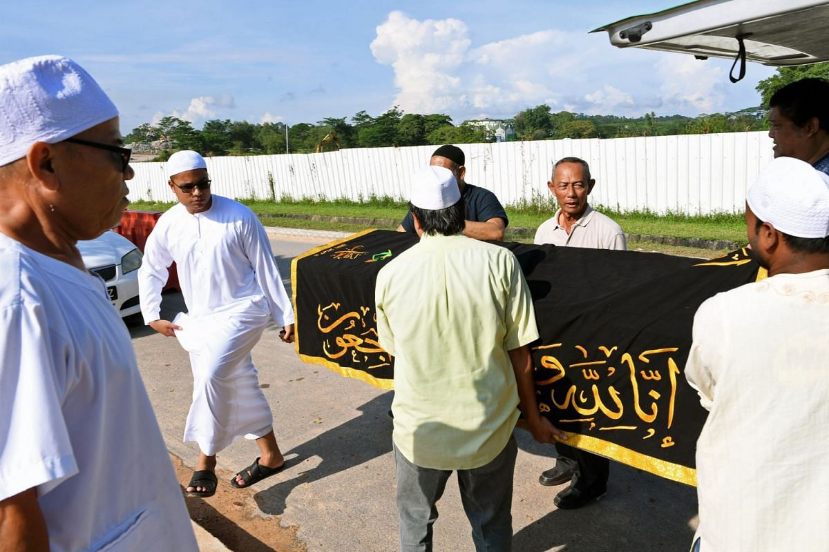 Mr Razaly helping other undertakers carry a body from the hearse to the burial grounds during the Jenazah Management Course. He sees his work as a learning journey because he says every death he handles is different.