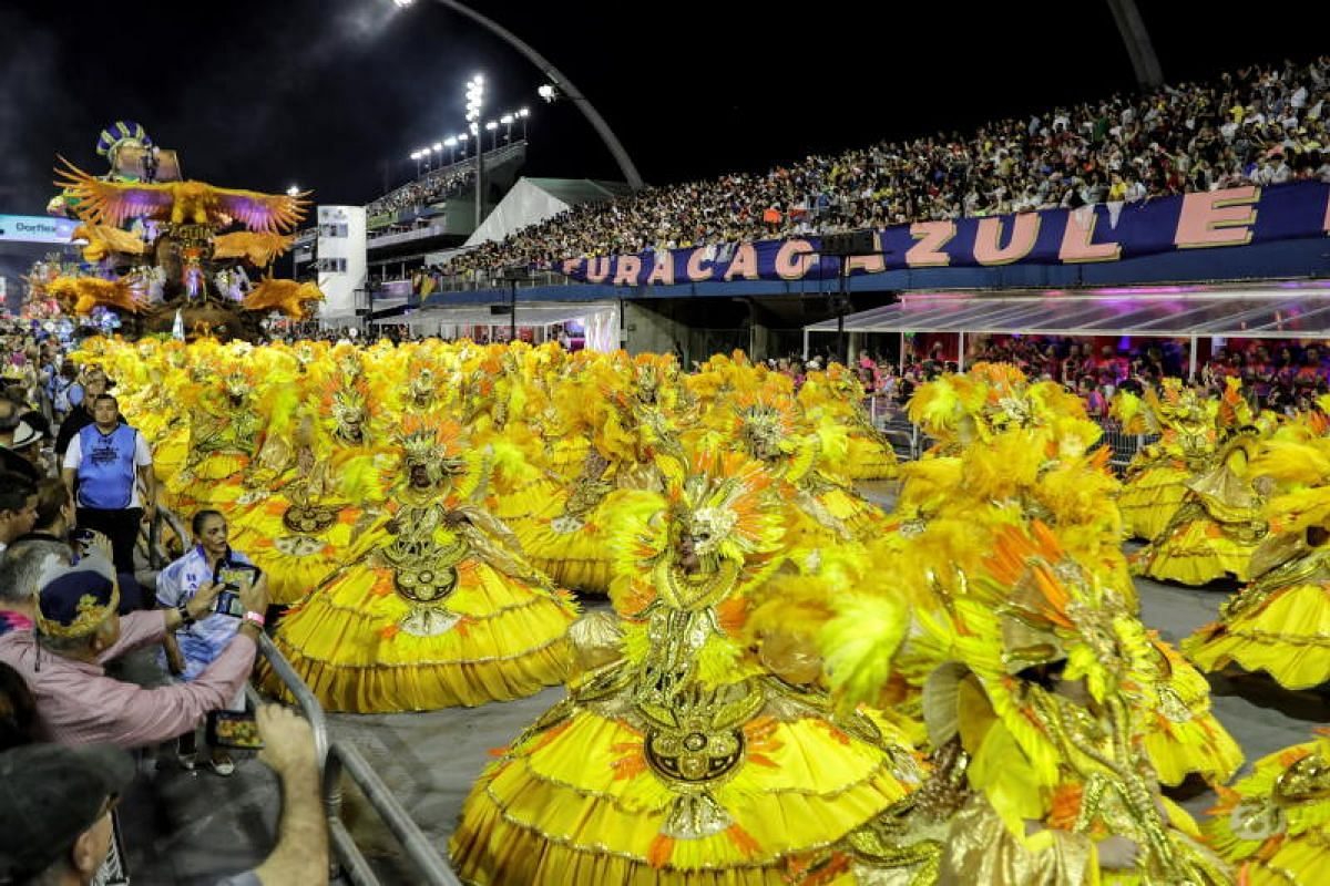 Members of the Aguia de Ouro samba school perform during the Carnival celebration at the Anhembi Sambadrome in Sao Paulo, Brazil on March 2, 2019.