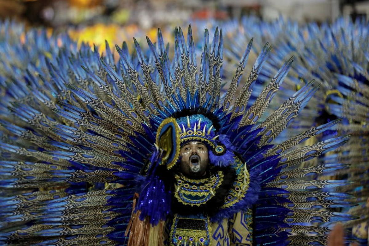 Members of the Aguia de Ouro samba school perform during the Carnival celebration at the Anhembi Sambadrome in Sao Paulo, Brazil, on March 2, 2019.
