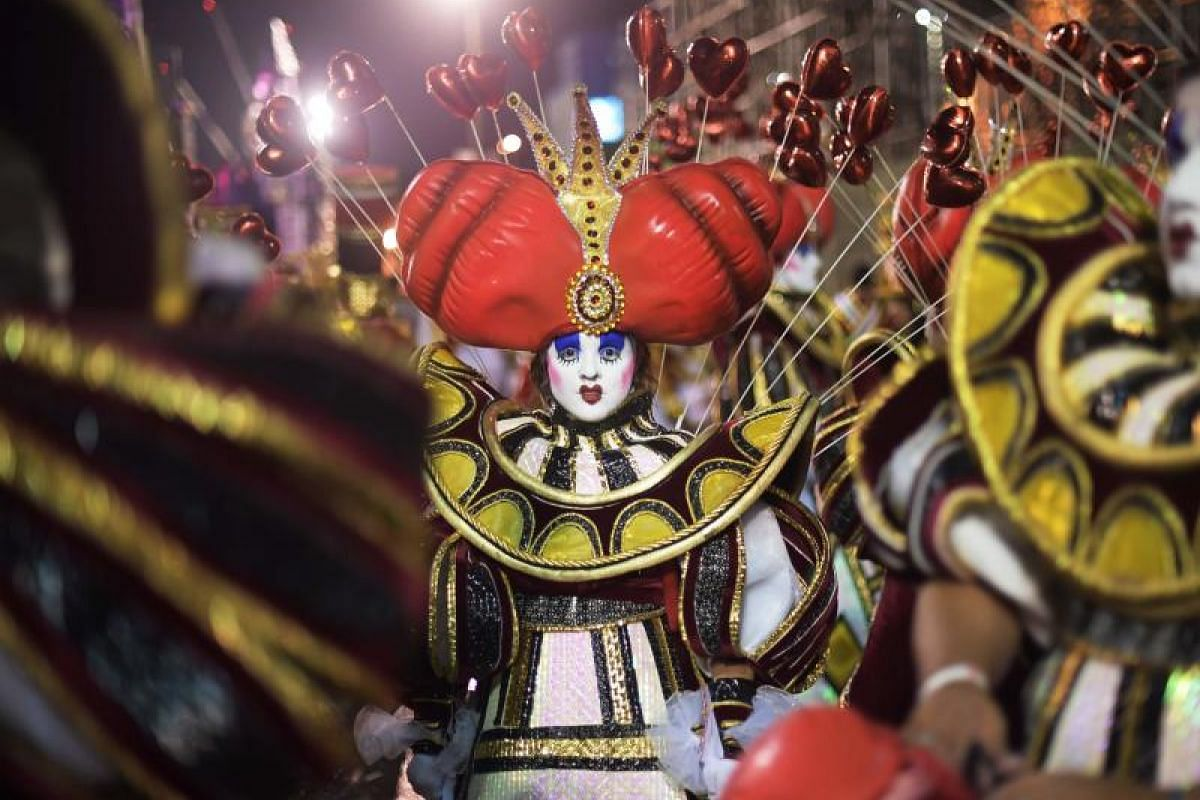 Performers of the Imperio Serrano samba school waiting for their turn to perform at the Rio Carnival parade at the Sambodrome in Rio de Janeiro, Brazil, on March 3, 2019.