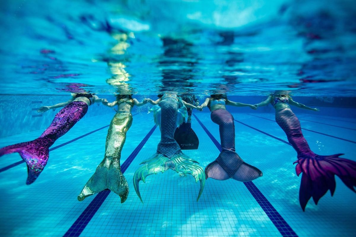 A photo issued on March 4, 2019 shows swimmers (L to R) twin sisters Teo Jia Yin and Teo Jia Qin, Naomi Wong Jiag, Koh Yi Xuen and Chan Yushi wearing mermaid tails, in a swimming pool in Klang, Malaysia. The women are part of a small but growing tren