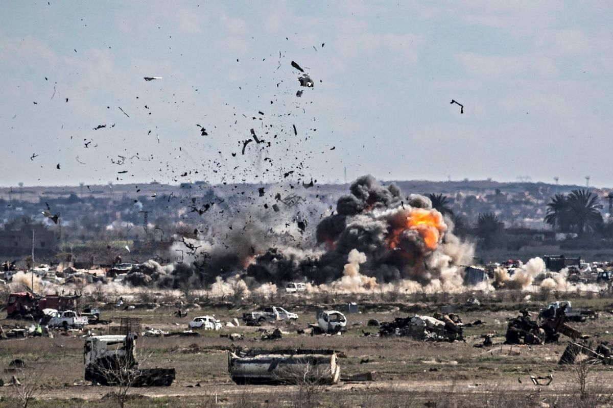 Smoke and fire billow after shelling on the Islamic State group's last holdout of Baghouz, in the eastern Syrian Deir Ezzor province on March 3, 2019. PHOTO: AFP