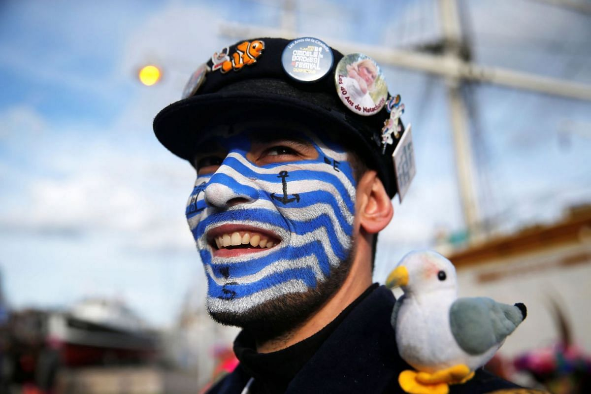 """A reveller wears a local Carnival costume during the parade of """"Carnaval de Dunkerque"""" in Dunkirk, France March 4, 2019. PHOTO: REUTERS"""