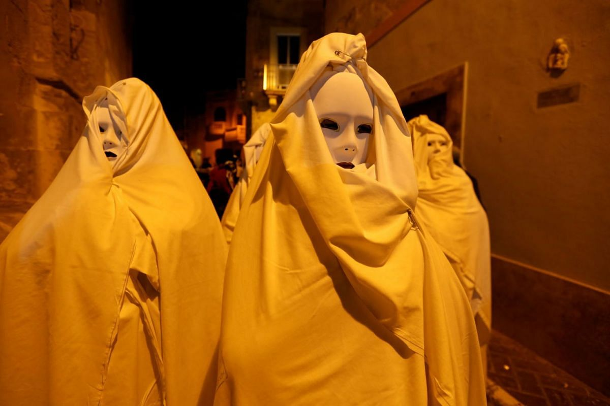 Masked revellers take part in a spontaneous carnival characterised by improvisation, satire and the macabre, in the village of Ghaxaq, Malta March 4, 2019. PHOTO: REUTERS