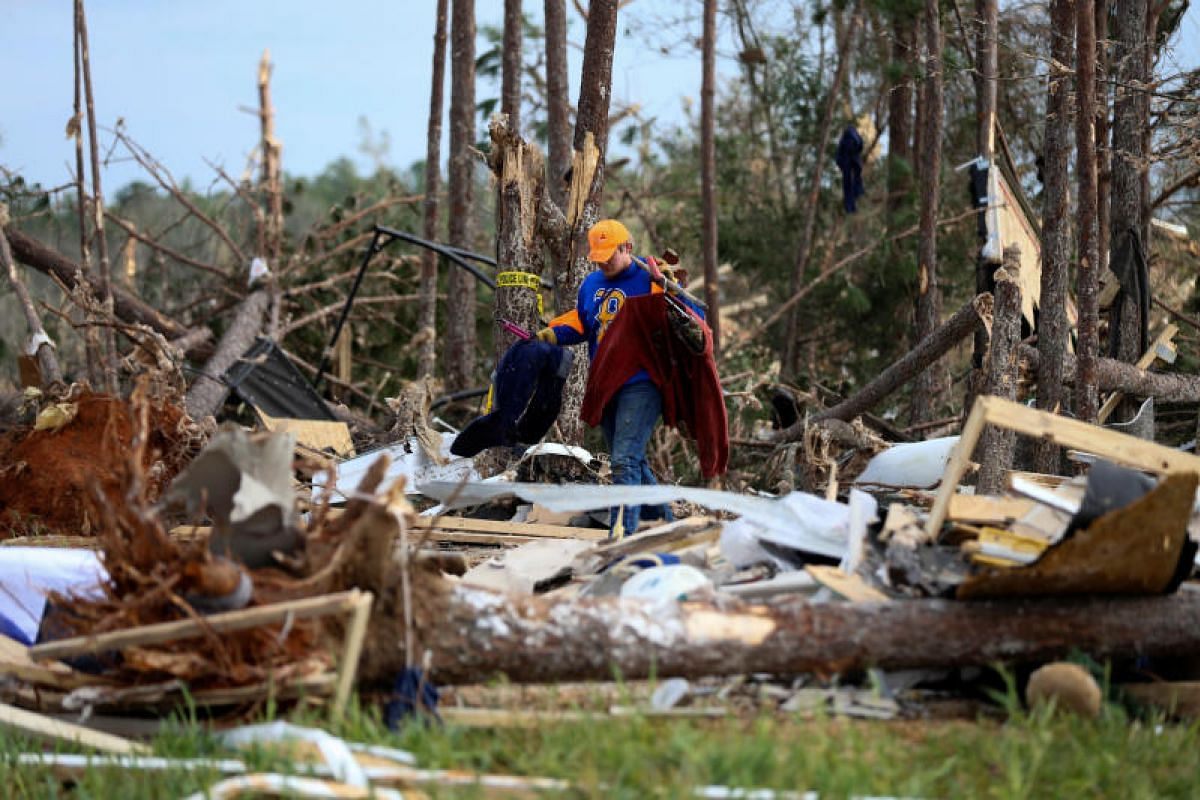 Mr Sean Brown recovers items from the wreckage of his home after two deadly back-to-back tornadoes in Beauregard, Alabama, on March 4, 2019.