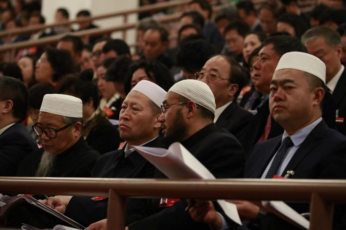 Muslim delegates attend the opening of the second session of the 13th National People's Congress at the Great Hall of the People in Beijing on March 5, 2019.