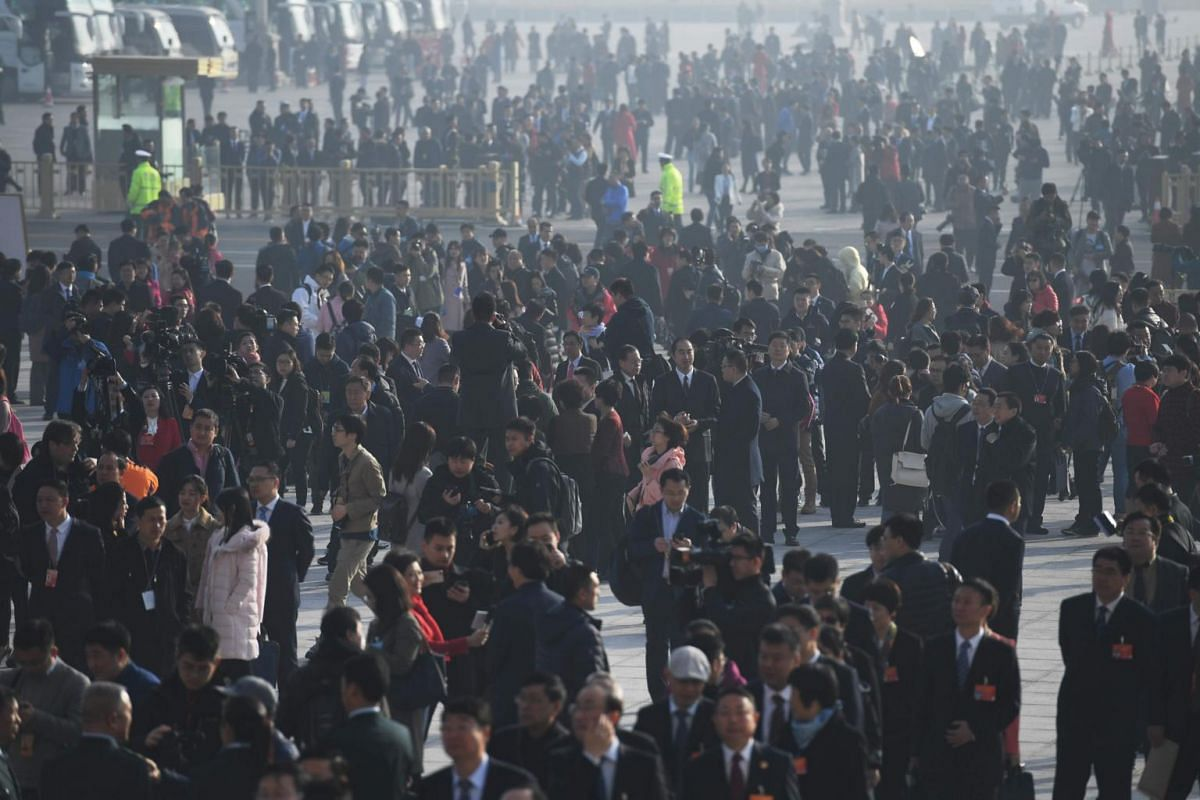 Delegates gather outside the Great Hall of the People in Beijing at the opening of the second session of the 13th National People's Congress.