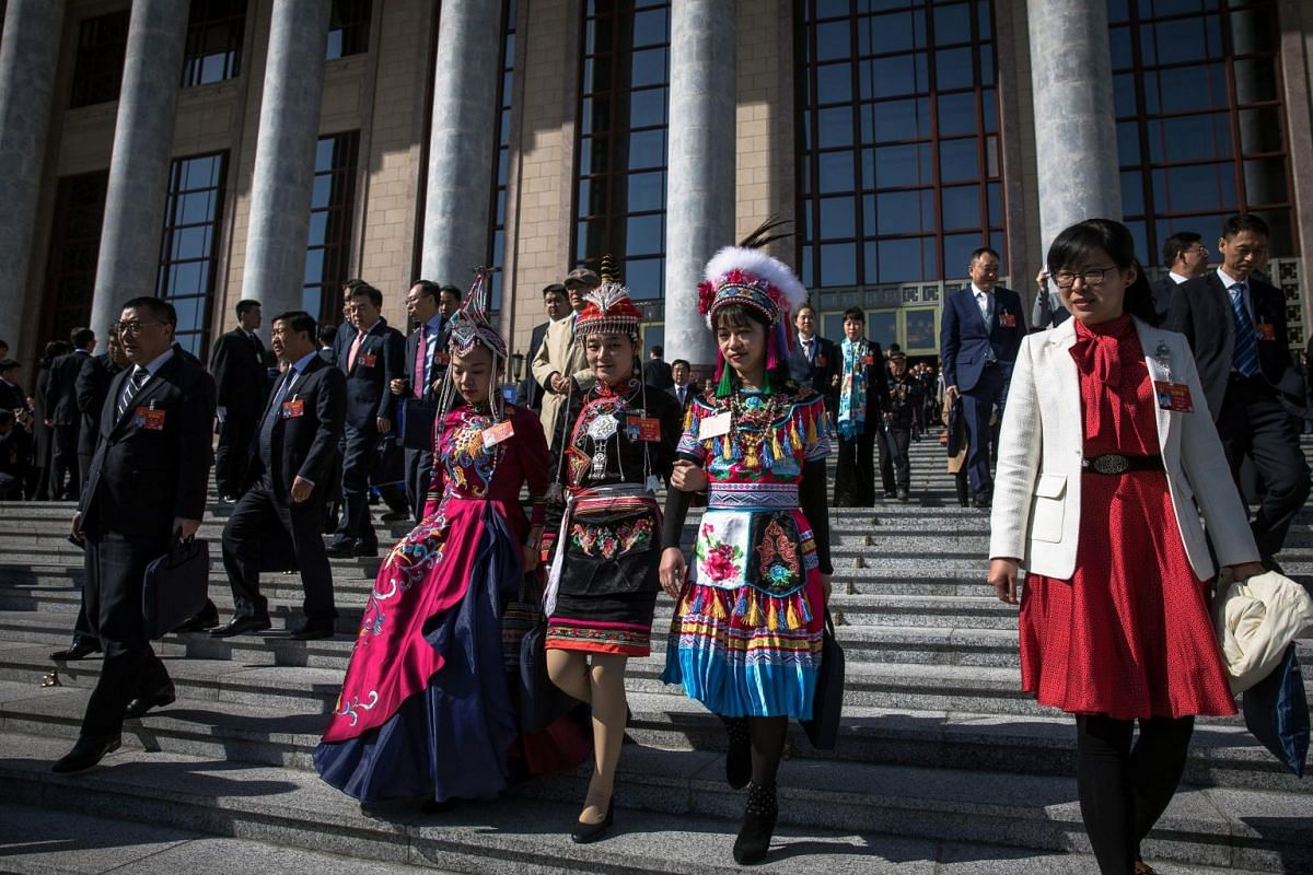 Delegates leave after the opening of the second session of the 13th National People's Congress.