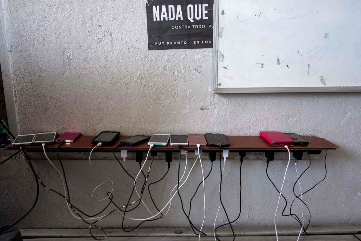 Cellphones of migrants seeking for asylum in the United States are seen charging in Juventud 2000 migrant shelter in Tijuana, on March 5, 2019. According to the US Customs and Border Protection, statistics observed more than a 300 percent increase in
